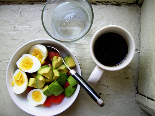 hardboiled eggs, avocado and tomato, water, coffee