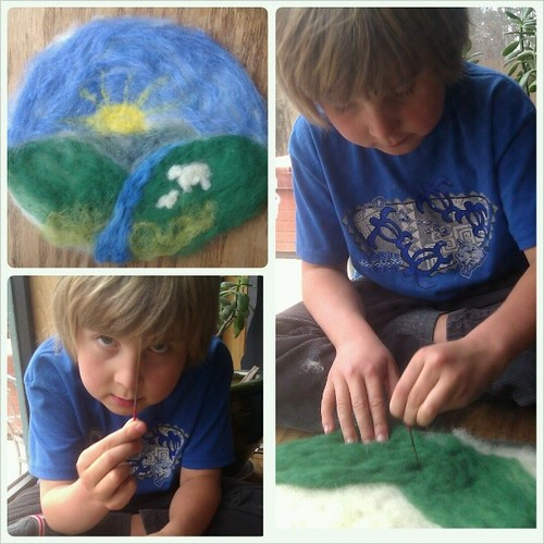 "We brought out the wool and made a little ""wool painting"" together for Imbolc. This was Asher's first time needle felting."