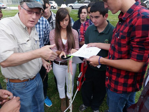 Greg Garvey, with NRCS Florida, works with TERRA students to prepare a transect for field data collection activities. Photo by: Yolanda Rivera, NRCS Florida.