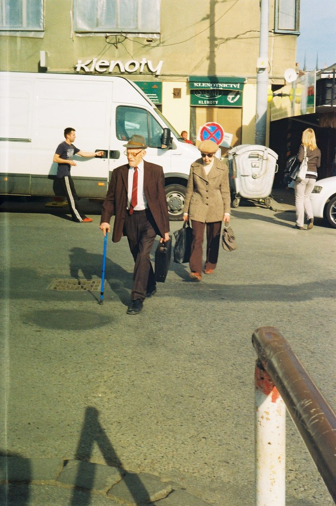 Beirette VSN - Elderly Couple Walking Towards the Bus