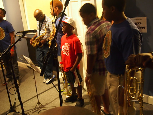 Theron Sanchez (trombone), Darryl Adams (alto sax), Demetris Chamblis (alto sax). Jeffrey Hills Jr, (trumpet), Ian Green (trumpet), Gregory Cyres (trumpet), of the Roots of Music Marching Crusaders Marching Band.