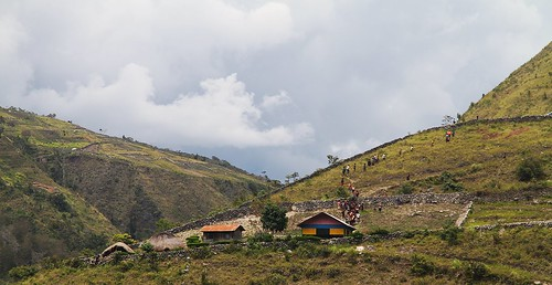 Papua province. Church parishioners and chain on a hillside in the Baliem valley.