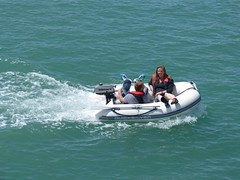 watercraft rowing(0.0), jet ski(0.0), personal water craft(0.0), dinghy(1.0), vehicle(1.0), sports(1.0), sea(1.0), powerboating(1.0), motorsport(1.0), boating(1.0), motorboat(1.0), inflatable boat(1.0), watercraft(1.0), boat(1.0),