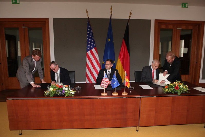 Ambassador Murphy signs the agreement