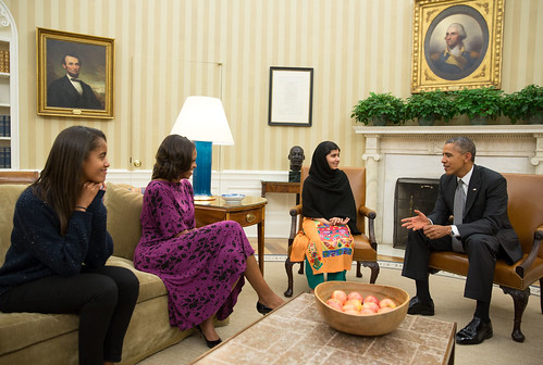 A White House handout featuring Obama meeting with Malala Yousafzai and probably not when she was confronting him for flying killer drones in her country.