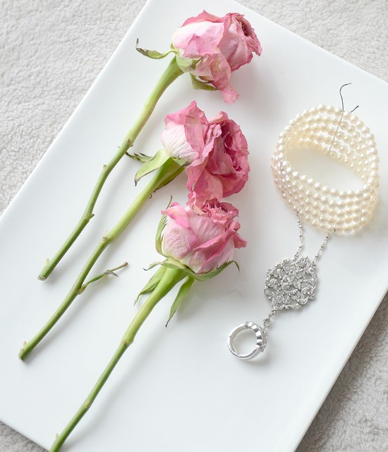 Pink roses and pearl bracelet