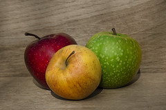 Fresh apple harvest on a wooden  background