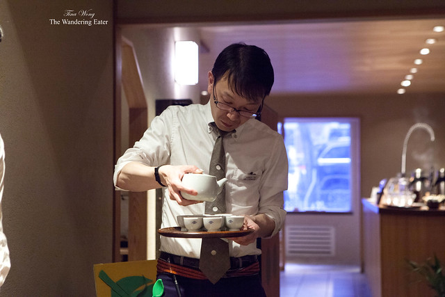 Male staff member pouring the prepared Sencha teas