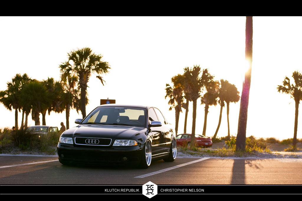 christopher nelson black audi b5 a4 1.8t quattro klutch republik sl14 18x9.5 slammed dropped dumped bagged static coilovers hella flush stanced stance fitment low lowered lowest camber wheels tucked 16s 17s 18s 19s 20s 3piece 1 piece custom airbags scene scenester