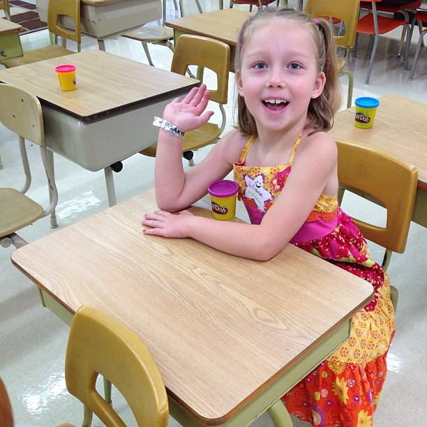 Her teacher had a container of playdoh at each desk so they'd have something to do while they wait for the other kids to arrive. In other words, her teacher is brilliant.