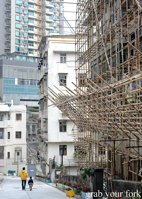 Father and son and bamboo scaffolding in Sheung Wan or the Upper district, Hong Kong