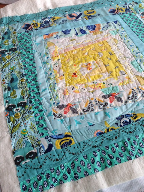 My quilting so far. Bee swirls in the middle, twigs all around. Hope u like what u see partner!