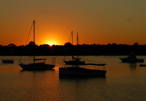 sunset water silhouette boats iron cove sydney nsw