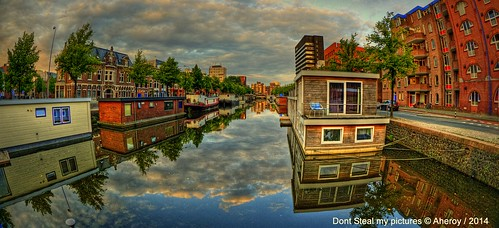 street city sunset holland art water netherlands strange dutch architecture clouds fun town canal europe colours different nederland surreal fisheye hallucination groningen houseboats stad streetshot tonemapped hoendiep singlerawhdr aheroy aheroyal beautifulgroningen canonef815mmf4lfisheye