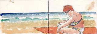 lectora en la playa de Zarautz