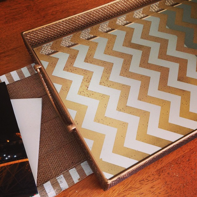 Happy Fall Y'all!!  I decided to clean out our entire coffee table (it has a ton of storage underneath) and buy a new tray for the top of it. This gold chevron mirror tray was 50% off at Hob Lobs! I couldn't believe it! I also bought some fall decor to de