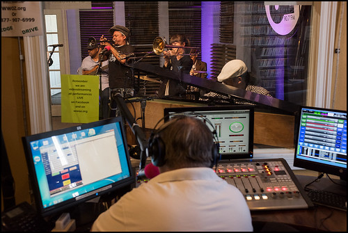 Michael Dominici watches Kermit Ruffins and the BBQ Swingers perform during WWOZ Spring pledge drive day 3 on March 16, 2017. Photo by Ryan Hodgson-Rigsbee www.rhrphoto.com