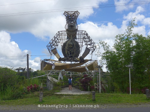I'm not sure what this represents. But the big person is wearing a native clothing and holding a durian that has a baby inside. DDD Habitat Inc. at Lorega, Kitaotao, Bukidnon