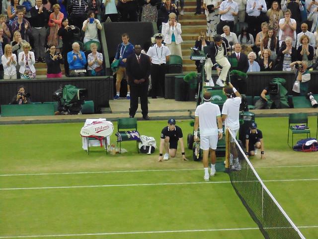 Gilles Muller and Roger Federer