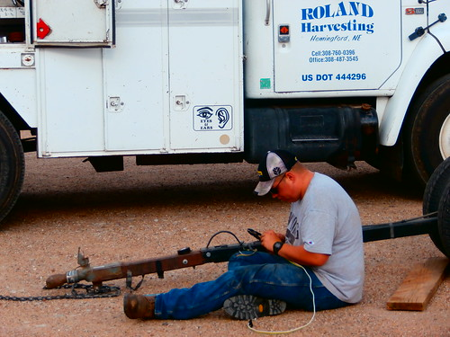 Matt doing electrical work on the header trailer