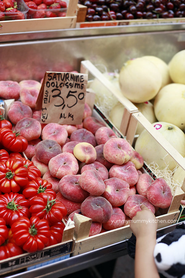 italy fruit and vegetable market in the summer with tomatoes and peaches