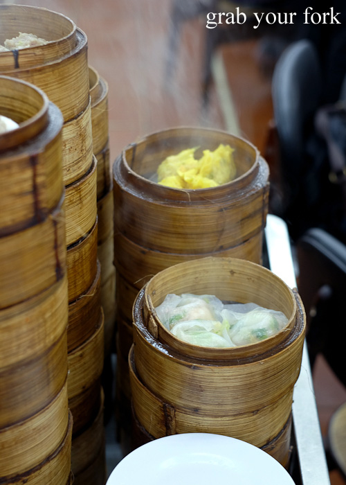 Steamed dumplings in bamboo baskets on the yum cha trolley at Lin Heung Tea House in Central, Hong Kong