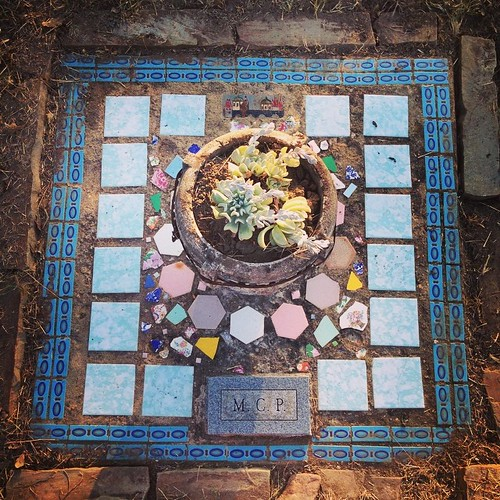 We cleaned up her mosaic grave marker, cleared it of grass and dirt, and put a succulent friend into the stone planter. M.C.P. R.I.P.