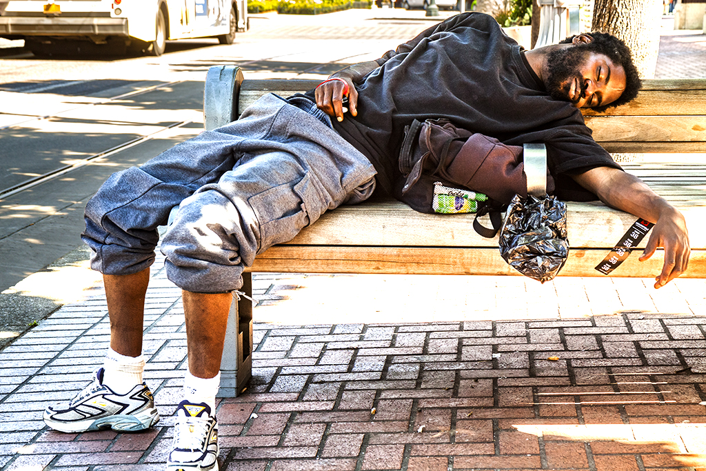 Man-sleeping-on-bench-near-Union-Station-on-6-30-14--Portland