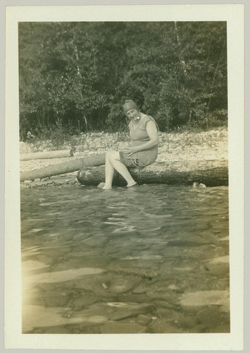 Girl sitting at water's edge