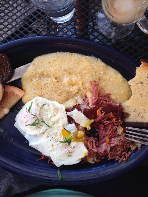 Corned beef hash with fried eggs and grits: brunch at Hot Suppa in Portland, ME.