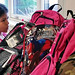 A San Ildefonso Day School student selects from a mountain of backpacks collected during this year's backpack and school supply drive.
