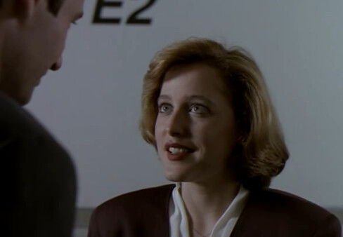Scully smiles