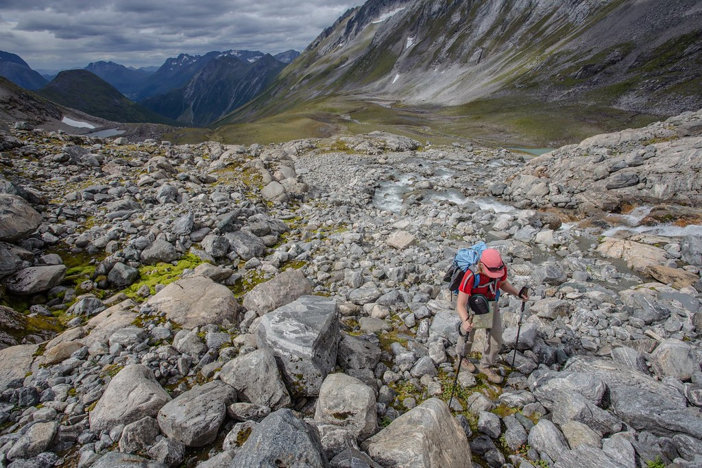 Climb towards the alpine crossing between Gullmorebreen and Gullmoredalsvatnet. Sunnmøre Alps. Norway.