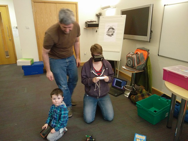 Lorraine Underwood and family playing with VR robots