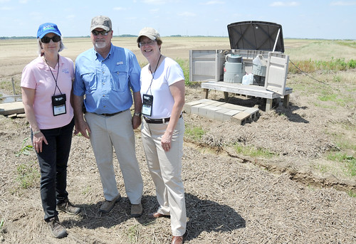 Terry Dabbs gives Ann Mills, USDA Deputy Under Secretary for Natural Resources and Environment, and Nancy Stoner, Environmental Protection Agency Acting Assistant Administrator for Water (right), a tour of his farm. (NRCS photo by Reginald L. Jackson)