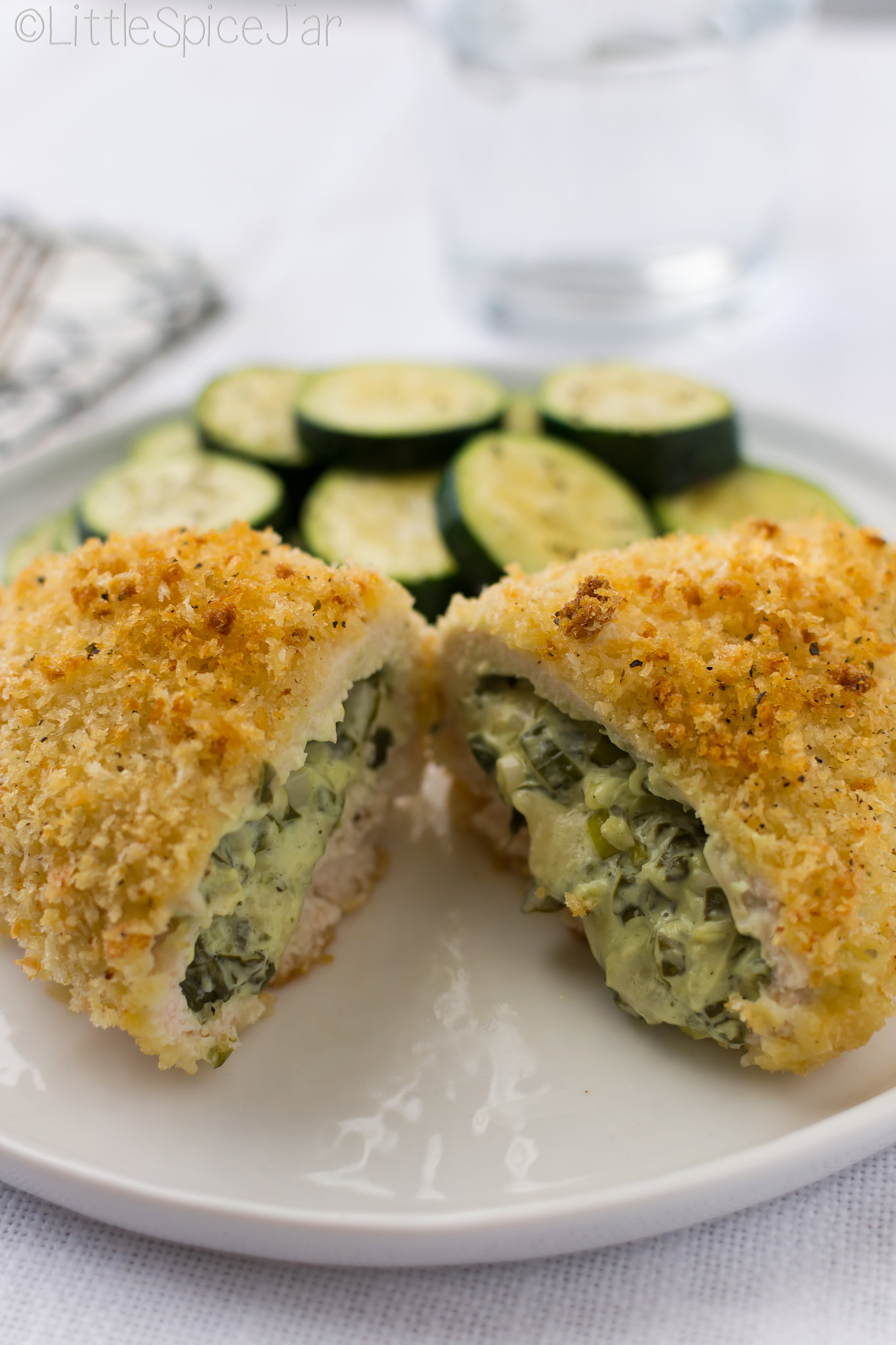 Spinach Cream Cheese Stuffed Chicken Breast -  loaded with scallions, cream cheese, and lots of spinach! #stuffedchickenbreast #chickendinner #stuffedchicken | Littlespicejar.com