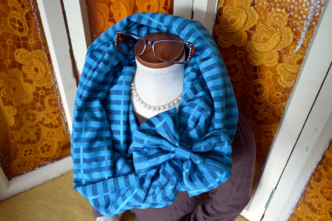 Adult Infinity Scarves, accented with a bow barrette