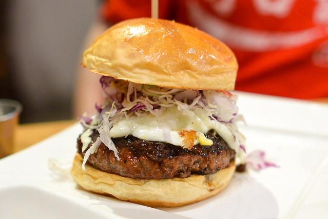 Ronin Burger Angus Beef, Caramelized Onions, Japanese Cole Slaw, Miso Goma Dressing, Fried Egg, Katsu BBQ, Yuzu Citrus Aioli