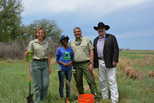 "A recent tree planting and habitat restoration service project at the Rocky Mountain Arsenal Wildlife Refuge was part of activities to announce $6.7 million in grants to support conservation employment and mentoring opportunities for youth on public lands. From left, Erin Connelly, Forest Supervisor of the Pike and San Isabel National Forest and Cimarron and Comanche National Grasslands; Agnes Mukagasana a youth from Groundwork Denver; Daniel Jirón a regional forester with the U.S. Forest Service; and USDA Deputy Undersecretary Arthur ""Butch"" Blazer were part of the tree planting and habitat restoration service project. (U.S. Forest Service)"
