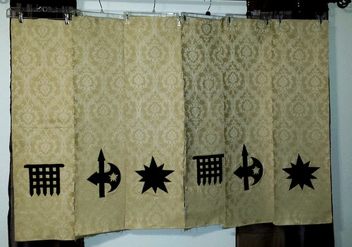 Stitching is finished and all the banners are backed.   Next is finishing hems and hangers.