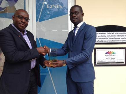 Cecil Sunkwa – Mills, General Manager receives a plaque of appreciation from Daniel Afari- Counselor at Leukemia Foundation