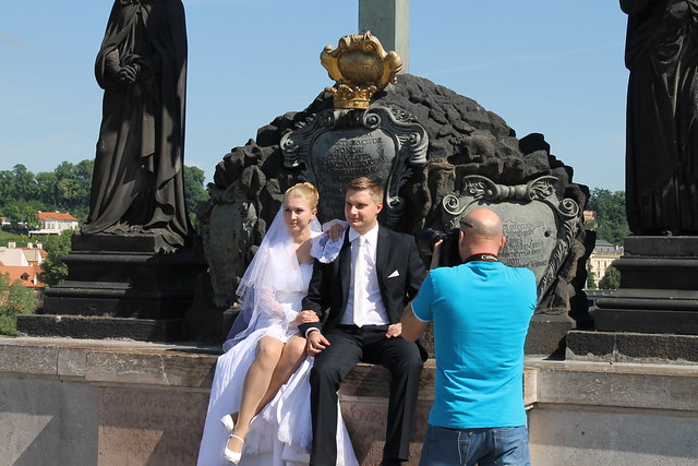 An ordinary day in Prague: Newlyweds doing a few portraits on Charles Bridge