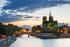 Early Green Enlightment on Notre Dame de Paris and Seine River at Dusk