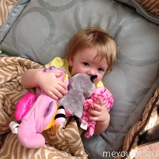 Snuggling with stuffed animals