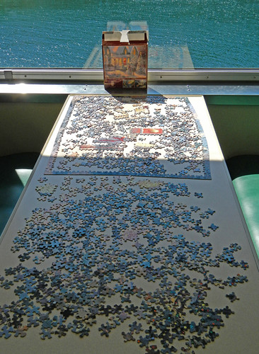 Jigsaw puzzles on many tables on the ferry to Port Townsend
