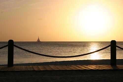 sunset sea sun reflection beach water boat sand aruba sail caribbean caribe
