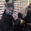 Papa Emeritus signing a skull. Is there anything more metal?