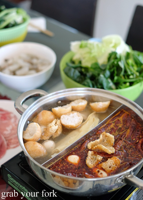 Steamboat hot pot soup with tofu puffs, pork crackling and chilli