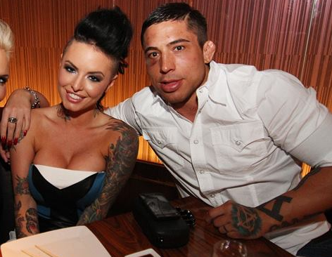 Christy Mack, left, sits with War Machine, aka Jon Koppenhaver
