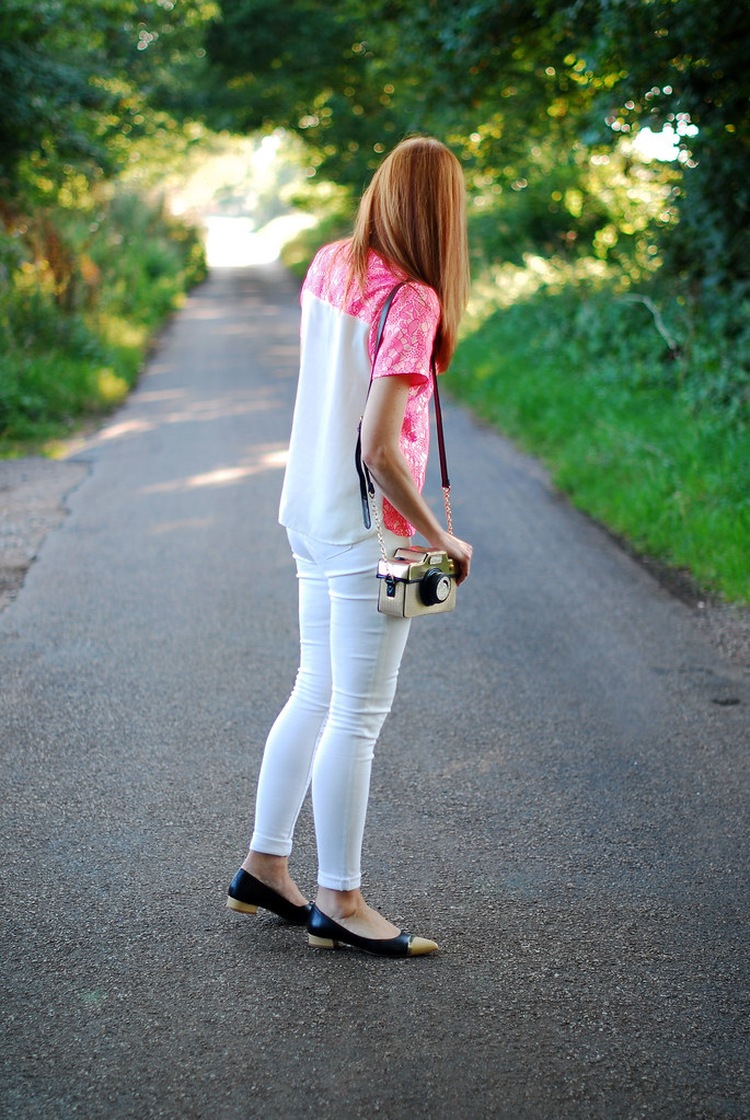 Neon pink top and white skinny jeans